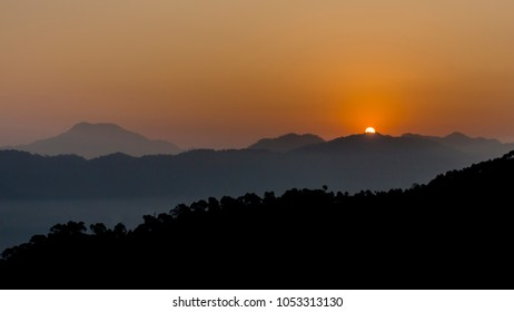 Kasauli, India - November 2017: The sun rising in the Indian Himalayan mountains