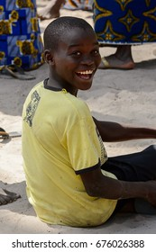 KASCHOUANE, SENEGAL - APR 29, 2017: Unidentified Diola boy sits on the ground in Kaschouane village. Diolas are the ethnic group predominate in the region of Casamance