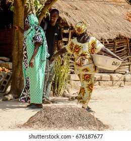KASCHOUANE, SENEGAL - APR 29, 2017: Unidentified Diola woman in traditional clothes stands in Kaschouane village. Diolas are the ethnic group predominate in the region of Casamance