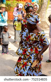 KASCHOUANE, SENEGAL - APR 29, 2017: Unidentified Diola women in national colored clothes and headscarves make a traditional Essipati dance in Kaschouane village.