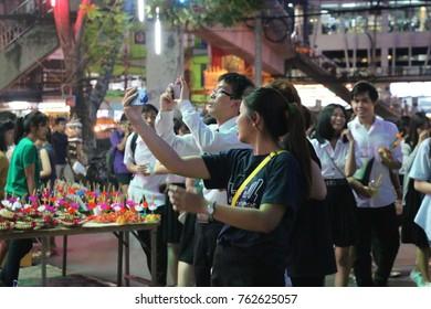 KASETSART UNIVERSITY, BANGKOK, THAILAND on 3 November 2017 : A photo of a girl taking selfie at Loy Krathong (Loi Kratong) festival.