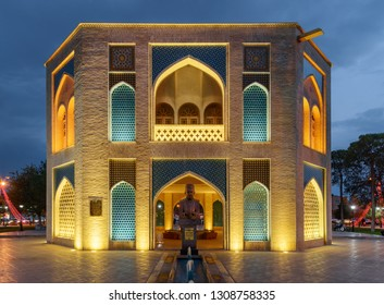 Kashan, Iran - 20 October, 2018: Wonderful evening view of colorful octagonal pavilion and bust of Iranian painter Mohammad Ghaffari in Kamal-ol-Molk Square. Traditional Persian architecture.