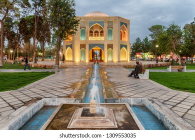 Kashan, Iran - 20 October, 2018: Wonderful evening view of Kamal-ol-Molk Square. Colorful traditional Persian octagonal pavilion and beautiful fountains. Residents resting in the square.