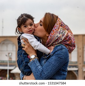 Kashan, Iran - 2019-04-14 - Naqshe Cehan Square mother kissed reluctant child.