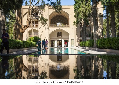 KASHAN, IRAN - AUGUST 12, 2016: Main alley of the Kashan Fin Garden, also known as Bagh e Fin park. It is a touristic landmark of Kashan, Iran, and a symbol of the Persian empire