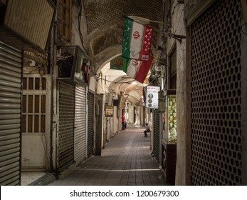 KASHAN, IRAN - AUGUST 13, 2015: Empty street of the Kashan main bazar in the afternoon in a covered alley of the market. Symbol of the Persian architecture, it's a major landmark of the city