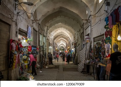 KASHAN, IRAN - AUGUST 13, 2015: Street of the Kashan main bazar in the afternoon in a covered alley of the market. Symbol of the Persian architecture, it's a major landmark of the city