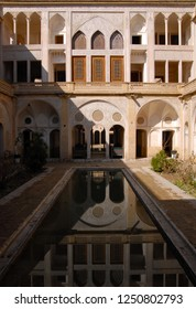 Kashan, Iran - January, 2009: Khan-e Abbasian historic house is one of the most popular touristic destination in Kashan. Courtyard with pool.