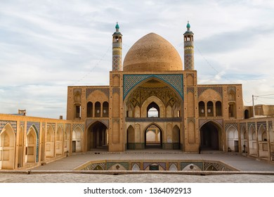 KASHAN, IRAN - NOV 20, 2016:View of Agha Bozorg Mosque on blue sky background in Kashan, Iran. Gorgeous Islamic architecture. The historical mosque and madrasa is a popular tourist attraction