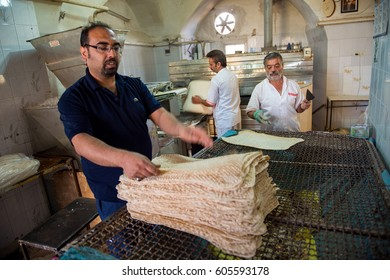 KASHAN, IRAN - October 21, 2016 : Naan (bread) taftoon factory, Iranian small bakery shop in Kashan city. Kashan  nowaday is one of a popular destination in Iran.