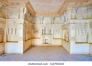 KASHAN, IRAN - OCTOBER 22, 2017: The plaster muqarnas decorations on walls of Five-Door Room (Shahneshin, Panjdari) of Abbasi House, on October 22 in Kashan.