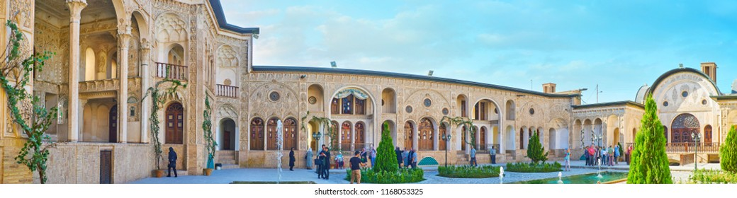 KASHAN, IRAN - OCTOBER 22, 2017: Panorama of Tabatabaei House and its pleasant garden with tiny trees, flower beds and fountains, amid the ornate walls and terraces, on October 22 in Kashan.