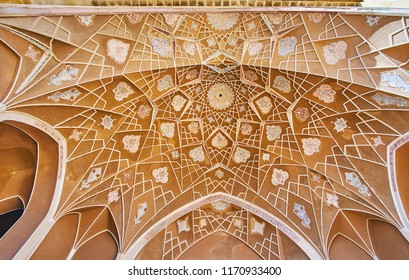 KASHAN, IRAN - OCTOBER 22, 2017: The semi-dome of the portal (iwan) in courtyard of Abbasi House with relief arabesques, on October 22 in Kashan.
