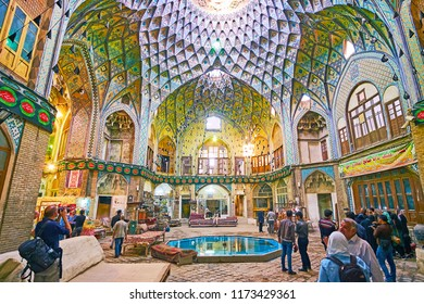 KASHAN, IRAN - OCTOBER 22, 2017:  Aminoddole Caravanserai of Grand Bazaar with carpet and antique shops, teahouse in splendid hall with carved details and tile arabesques, on October 22 in Kashan.