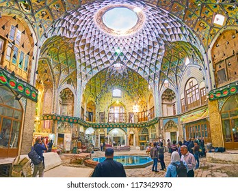 KASHAN, IRAN - OCTOBER 22, 2017: Panorama of posh decorated Timche-ye Amin od-Dowleh hall of Grand Bazaar with relief brick patterns, tiled ornaments and light hole amid the dome, on October in Kashan