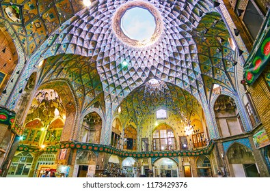 KASHAN, IRAN - OCTOBER 22, 2017:  The light hole in ornate dome of Timche-ye Amin od-Dowleh (Aminoddole Caravanserai) hall of Grand Bazaar, on October 22 in Kashan.
