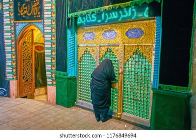 KASHAN, IRAN - OCTOBER 22, 2017: The Shia Muslim woman prays at the mausoleum in Grand Bazaar building, on October 22 in Kashan.