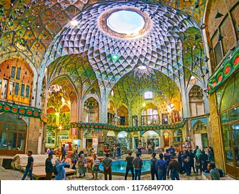 KASHAN, IRAN - OCTOBER 22, 2017: Panorama of large hall of Aminoddole Caravanserai, located in Grand Bazaar and decorated with brickwork, Islamic patterns and muqarnas details, on October 22 in Kashan