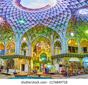 KASHAN, IRAN - OCTOBER 22, 2017: One giant light hole and many small holes and windows provide the dailylight to the ornate Aminoddole Caravanserai, located in Grand Bazaar, on October 22 in Kashan.