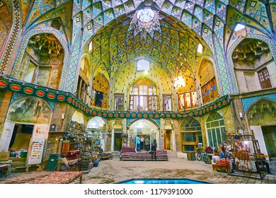 KASHAN, IRAN - OCTOBER 22, 2017: Aminoddole Caravanserai (Timche-ye Amin od-Dowleh) is occupied with carpet and antique shops, textie store with old hand-loom at the entrance, on October 22 in Kashan.