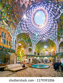 KASHAN, IRAN - OCTOBER 22, 2017: The ornate Aminoddole Caravanserai is the most famous part of Grand Bazaar among the tourists, enjoying its interior and visit local stores, on October 22 in Kashan.