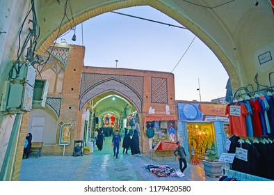 KASHAN, IRAN - OCTOBER 22, 2017: Walk the narrow alleyways of Grand Bazaar, enjoy local trading traditions, choose the gifts and souvenirs from Kashan, on October 22 in Kashan