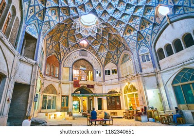 KASHAN, IRAN - OCTOBER 22, 2017: Interior of the large hall of Hajj Seyed Hossein Sabbaq Timcheh Caravanserai of Grand Bazaar with carpet stores and workshops, on October 22 in Kashan.