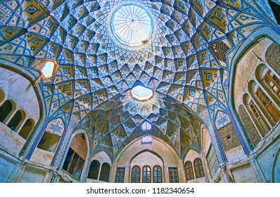 KASHAN, IRAN - OCTOBER 22, 2017: The scenic dome of Hajj Seyed Hossein Sabbaq Timcheh Caravanserai, covered with brick muqarnas decors and tile pattern, Grand Bazaar, on October 22 in Kashan.