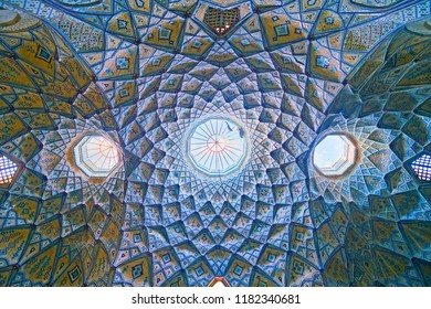 KASHAN, IRAN - OCTOBER 22, 2017: The stunning cupola of Hajj Seyed Hossein Sabbaq Timcheh Caravanserai, with complex brickwork and tiled patterns in blue gamma, Grand Bazaar, on October 22 in Kashan.