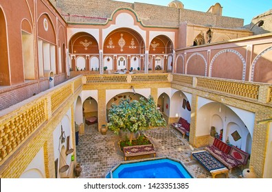 KASHAN, IRAN - OCTOBER 23, 2017: The deep courtyard of historical Iranian house modifies the microclimate, providing cool fresh air, on October 23 in Kashan
