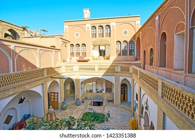KASHAN, IRAN - OCTOBER 23, 2017: The fine example of historical Persian living architecture with deep shady courtyard, surrounded by living area with narrow corridors, on October 23 in Kashan