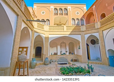 KASHAN, IRAN - OCTOBER 23, 2017: The shady courtyard of traditional Iranian house with many narrow corridors, to provide cool air and wind, on October 23 in Kashan
