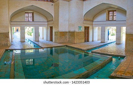 KASHAN, IRAN - OCTOBER 23, 2017: Interior of Kushak - the pool house, with arched niches, exits from all sides and narrow fountains, branching from the main pool, on October 23 in Kashan.