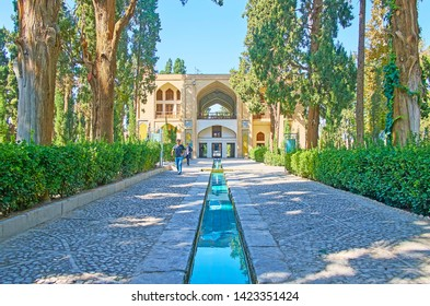 KASHAN, IRAN - OCTOBER 23, 2017: The alleys of Fin Garden are provided with narrow water streams, connecting in the middle of Kushak - the pool house, on October 23 in Kashan.