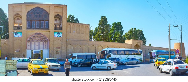 KASHAN, IRAN - OCTOBER 23, 2017: Panorama of huge ramparts and main entrance portal of historical Fin Garden, on October 23 in Kashan.