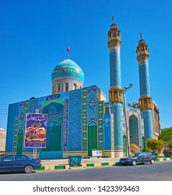 KASHAN, IRAN - OCTOBER 23, 2017: Al-Masjid an-Nabawi (Nabawi Mosque) is ornate building in turquoise color gamma with fine tile patterns and Islamic calligraphy, on October 23 in Kashan.