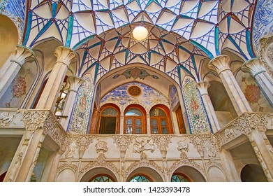 KASHAN, IRAN - OCTOBER 23, 2017: The outstanding interior (andarouni) of Borujerdi Historical House with a view on inner balcony, muqarnas dome, carved wall and pillars, on October 23 in Kashan.