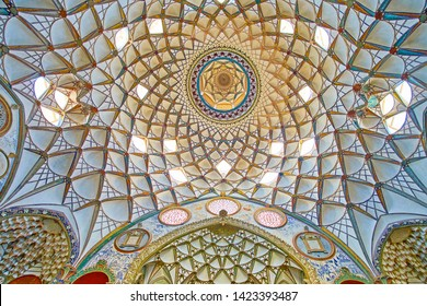 KASHAN, IRAN - OCTOBER 23, 2017:  Borujerdi Historical House boasts ornate interior with Persian decorations - muqarnas dome, painted and tile patterns, fine stucco reliefs, on October 23 in Kashan