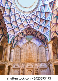KASHAN, IRAN - OCTOBER 23, 2017: The carved details of interior (andarouni) of Borujerdi Historical House with stucco muqarnas dome and fine patterns on wall, on October 23 in Kashan.