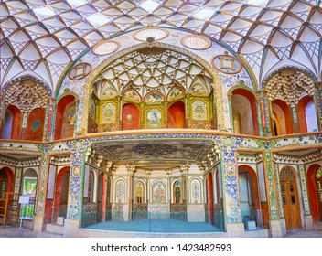 KASHAN, IRAN - OCTOBER 23, 2017: Panorama of Borujerdi Historic House main hall with complex decors, of dome and walls, including muqarnas, relief patterns, painted ornaments, on October 23 in Kashan.