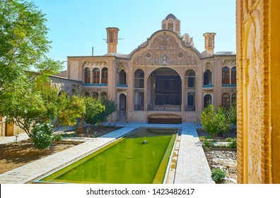 KASHAN, IRAN - OCTOBER 23, 2017: Observe the main portal and wind catchers (badgir towers) of Borujerdi Historical House from its terrace, on October 23 in Kashan.