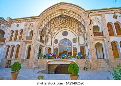 KASHAN, IRAN - OCTOBER 23, 2017: The picturesque courtyard of Sadeghi Traditional House with a view on its main portal, decorated with muqarnas dome, on October 23 in Kashan.