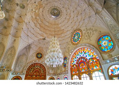 KASHAN, IRAN - OCTOBER 23, 2017: The splendid white hall of Sadeghi Traditional House with vintage glass chandelier, muqarnas cupola, fine mirrorwork, stained glass windows, on October 23 in Kashan.
