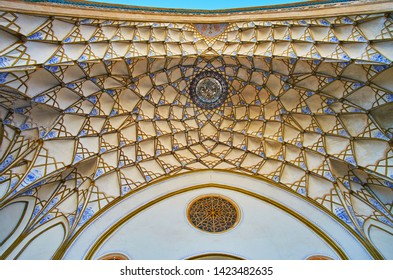 KASHAN, IRAN - OCTOBER 23, 2017: The scenic portal arch of Sadeghi Traditional House with muqarnas decor, covered with fine painted patterns, on October 23 in Kashan.