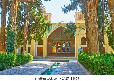 KASHAN, IRAN - OCTOBER 23, 2017: The view on historical building of the library with badgirs (wind catching towers), mosaic patterns and carved Persian screen, Fin Garden, on October 23 in Kashan