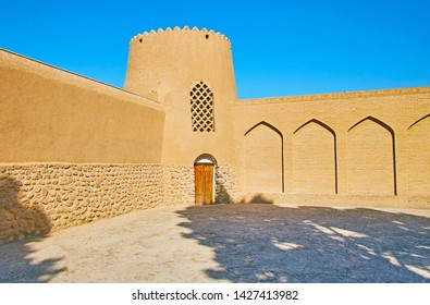 KASHAN, IRAN - OCTOBER 23, 2017: Preserved adobe tower and huge ramparts of oldest in country Persian garden - Fin garden, on October 23 in Kashan