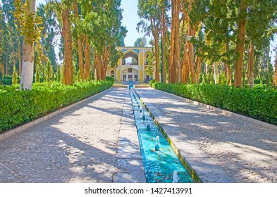 KASHAN, IRAN - OCTOBER 23, 2017: Historic Fin garden boasts own microclimate, modifying by tall shady trees and system of narrow cool water streams, flowing from the mountains, on October 23 in Kashan