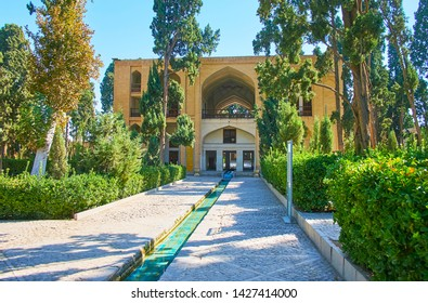 KASHAN, IRAN - OCTOBER 23, 2017: Fin garden is the best place to relax in shade of green trees, enjy the freshness of water streams and explore traditional Persian garden, on October 23 in Kashan