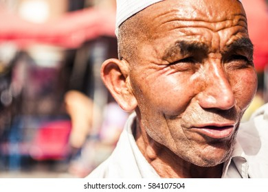 Kashgar, China - 28 June, 2009: Portrait of Uyghur man at the Sunday Market, a weekly marketplace that draws people from hundreds of kilometers, in Kashgar