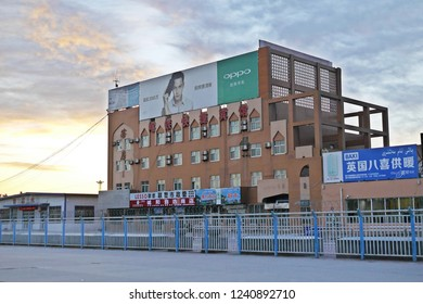 KASHGAR, CHINA - MAY 7, 2018: The main building of Kashgar railway station in the morning with beautiful sky and sunlight background, Xinjiang Uygur Autonomous Region, Western China.